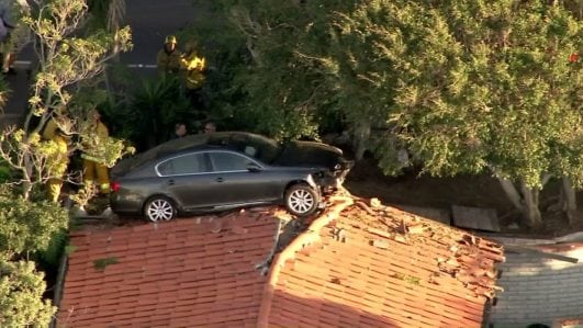 Car Lands on Top of Roof