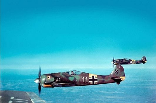 Beautiful color image of the German Focke-Wulf Fw 190A-5 fighters, of Fighter Squadron JG54, during flight, 1943.