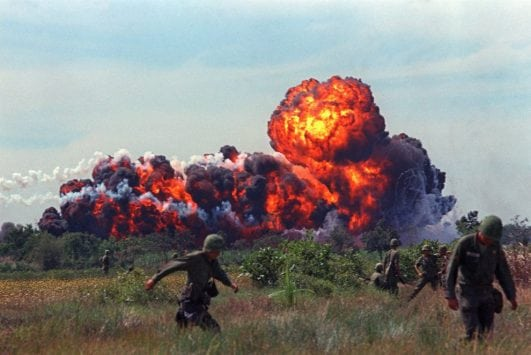 A napalm attack near U.S. troops on patrol in South Vietnam, circa 1966.